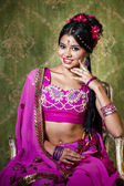 Young pretty woman in indian red dress — ストック写真