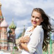 Young beautiful girl holding a tourist map of Moscow — Stock Photo #54885733