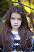 Beautifal little girl in the autumn park  — Stock Photo