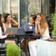 Interracial business team working at laptop in a office outdoor — Stock Photo #56069945