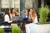 Interracial business team working at laptop in a office outdoor — Stock Photo