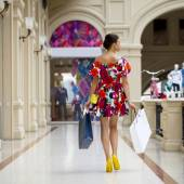 Young woman in sexy dress walking in the shop — Stock Photo