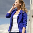 Beautiful young blonde calling by phone — Stock Photo #56240301