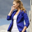Beautiful young blonde calling by phone — Stock Photo #56240323