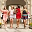 Four shopping women walking in shop — Stock Photo #56566283