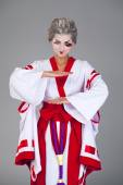 Beautiful young woman in white kimono — Stock Photo
