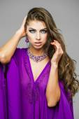 Portrait of the young sexy woman in purple  tunic Arabic — Stock Photo