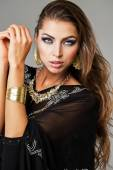 Portrait of the young sexy woman in black tunic Arabic — Stock Photo