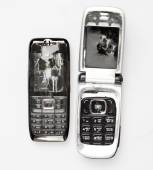 Two Broken mobile phone isolated on white  — Stock Photo