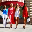 Four shopping women walking at the red square in Moscow — Stock Photo #60669965