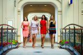 Four shopping women walking in shop — Stock Photo