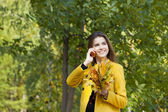 Happy beautiful woman calling by phone  — Stock Photo