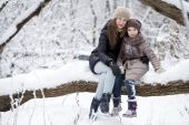 Winter portrait of a nine year girl with her mother — Stock Photo