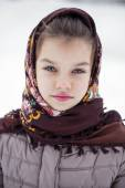 Happy little girl on the background of a winter park — Stock Photo