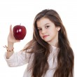 Portrait of a beautiful little girl holding a red apple — Stock Photo #64650849