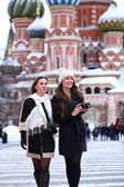 Two girls tourists are photographed in Moscow (Russia)  — Stock Photo
