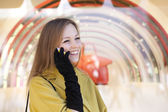 Happy beautiful girl calling by phone — Stock Photo