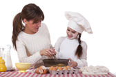 Happy mother with little daughter joyful cooking — Stock Photo