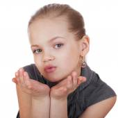 Blonde little Girl Blowing a Kiss, isolated on white background — Stock Photo