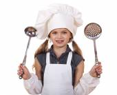 Cooking and people concept - smiling little girl in cook hat — Stock Photo