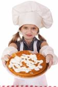 Beautiful happy seven year old girl in chef uniform with shortca — Stock Photo