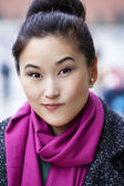 Young Asian woman walking on spring city in Russia — Stock Photo