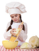 Portrait of a little girl in a white apron and chefs hat shred c — Stock Photo