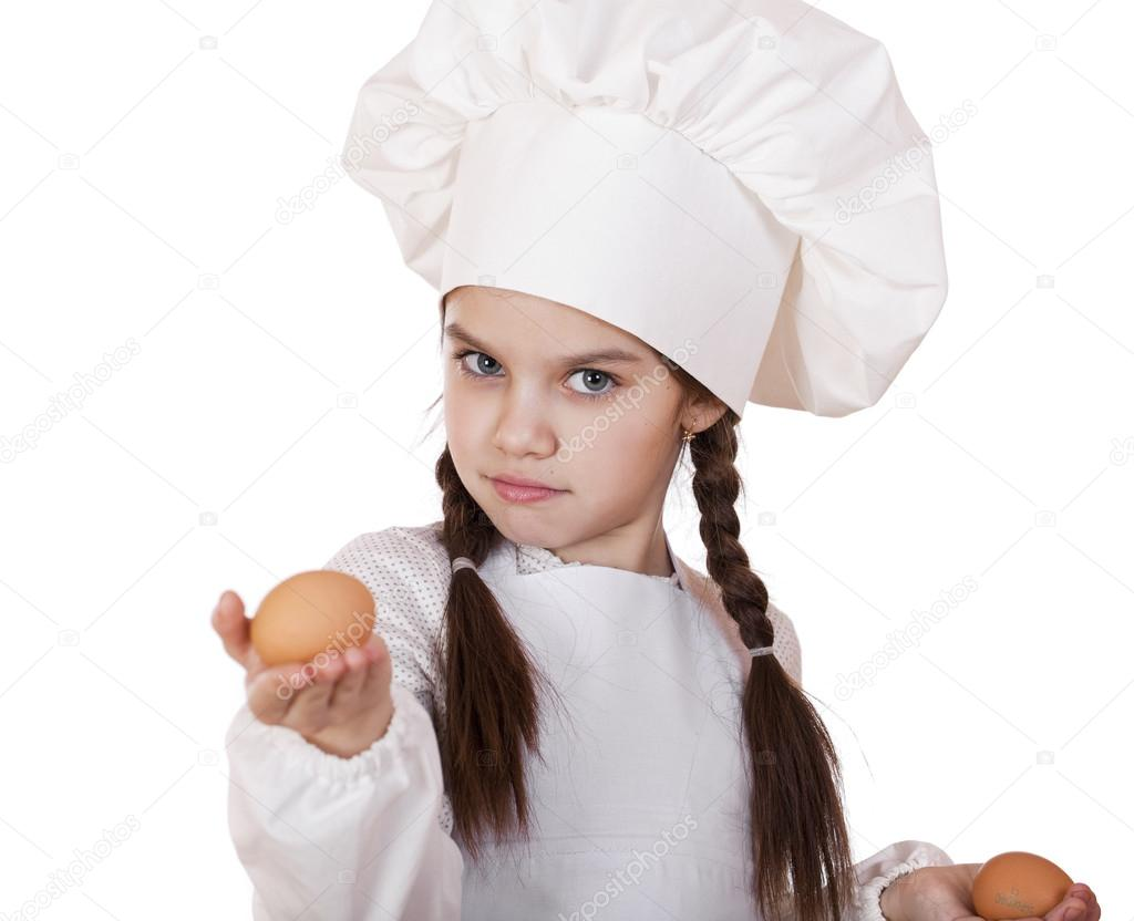 White apron girl - Portrait Of A Little Girl In A White Apron Holding Two Chicken E Stock Photo