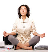 Attractive white collar worker meditating in office — Stock Photo