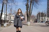 Schoolgirl walking on spring sunny street — Stock Photo