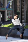 Beautiful business woman sitting on a bench  — ストック写真