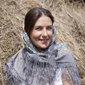 Portrait of a beautiful young woman in a blue scarf — Stock Photo