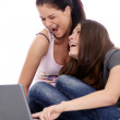 Two young women using laptop — Stock Photo #70488871