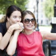 Happy young women taking pictures on your phone — Stock Photo #70489625