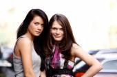 Couple women - brown hair against the brunette — Stock Photo