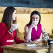 Two young women having lunch break together — Stock Photo #70647087