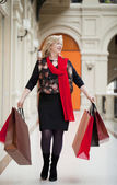Mature happy woman with shopping bags — Stockfoto