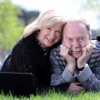 Portrait of a happy mature couple outdoors — Stock Photo #70832819