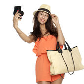Happy young woman using a camera to take photo — Stock Photo