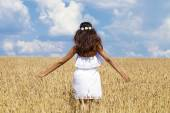 Young woman in a wheat golden field — Stock Photo