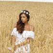 Young woman in a wheat golden field — Stock Photo #71897535