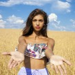 Sexy young happy girl holds hands in a wheat field — Stock Photo #71897921