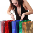 Happy young brunette girl with colorful shopping bags in sexy dr — Stock Photo #71907481