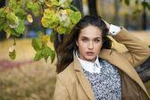 Portrait of young Italians in beige coat — Stock Photo