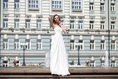 Full length portrait of beautiful model woman with long legs wea — Stock Photo