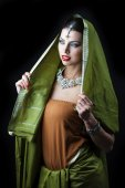 Young pretty woman in green indian dress — Stock Photo