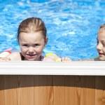 Two sisters in bikini near swimming pool. Hot Summer — Stock Photo #76073551