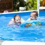 Two sisters in bikini near swimming pool. Hot Summer — Stock Photo #76073563