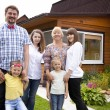 Big happy family portrait on the background of a country house — Stock Photo #76073631