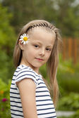 Close up portrait of a seven year little girl, against backgroun — Stock Photo